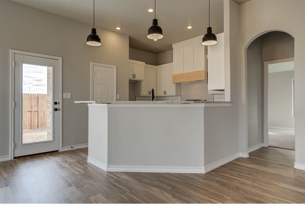 View of kitchen area from living in new home for sale in Lubbock.