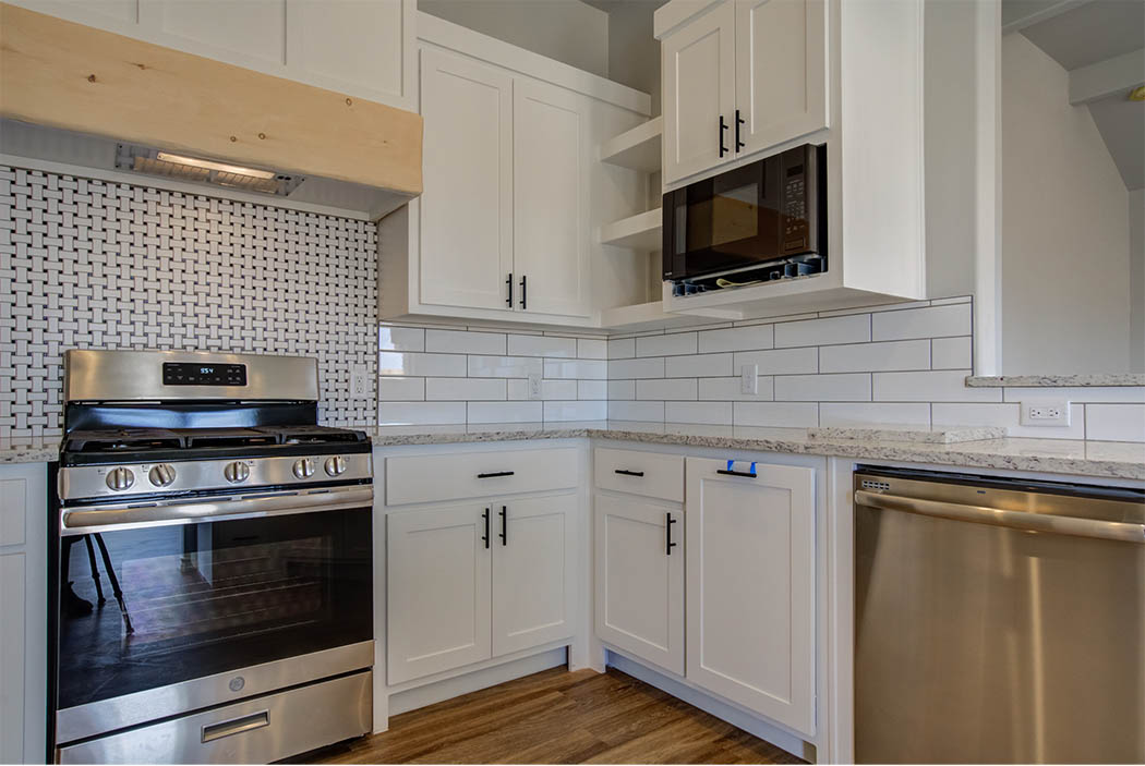 Spacioius kitchen with lots of cabinets in new home for sale in Lubbock, Texas.