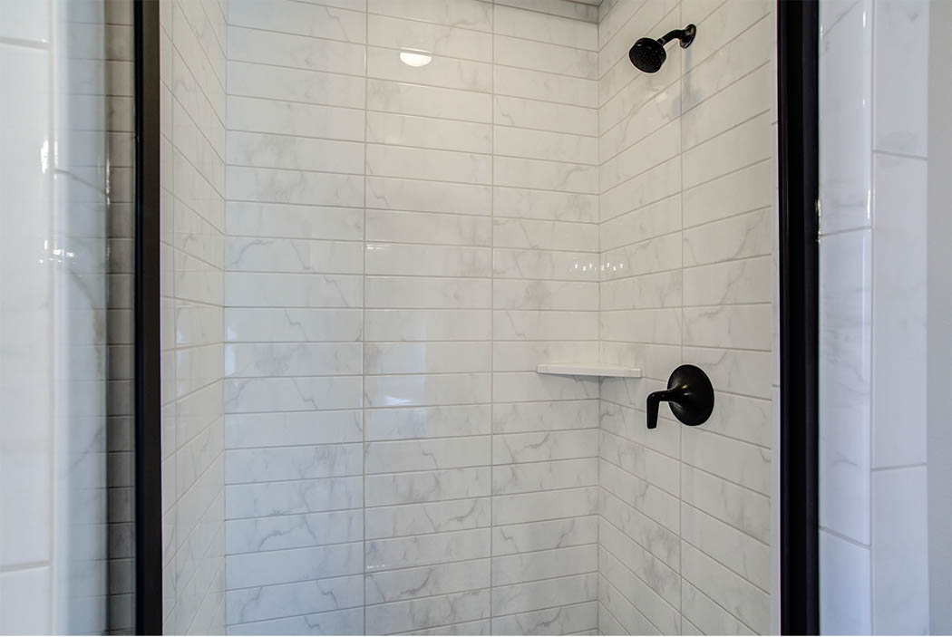 Detail of shower tile treatment in master bath of new home built by Sharkey Custom Homes of Lubbock.