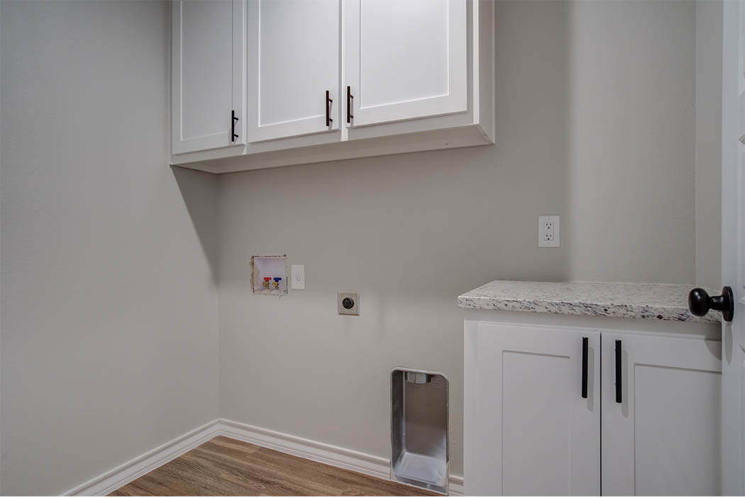 Spacious laundry room in new Lubbock, Texas home for sale.