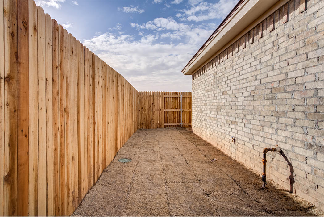 Side yard in new Lubbock home for sale.