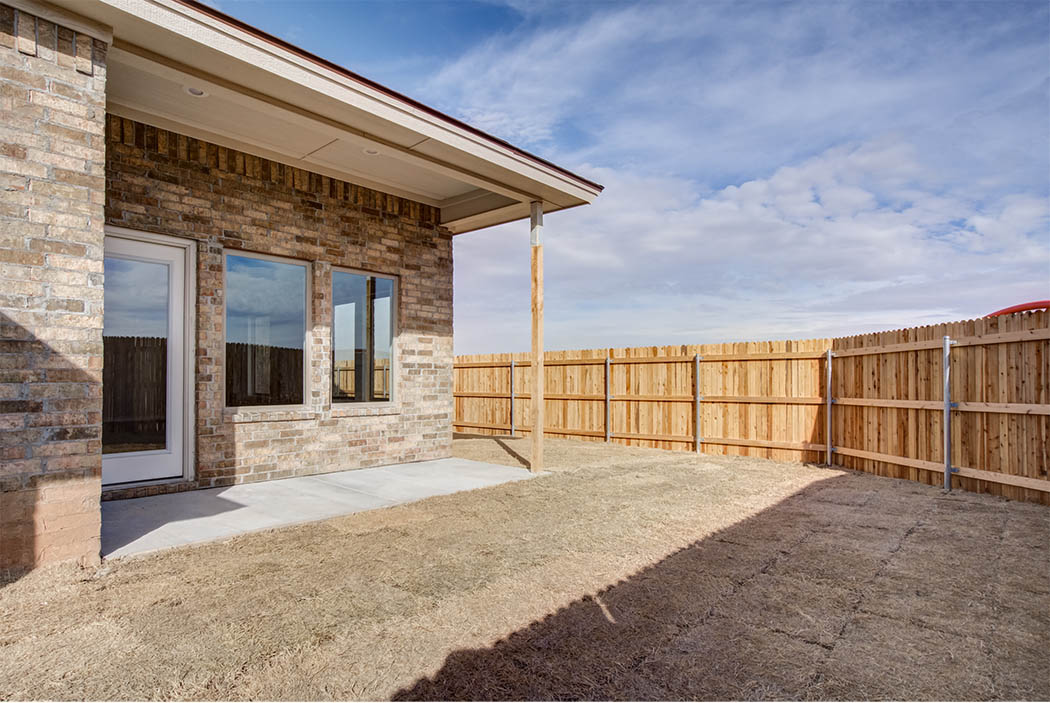 Backyard and patio of new Lubbock home for sale.
