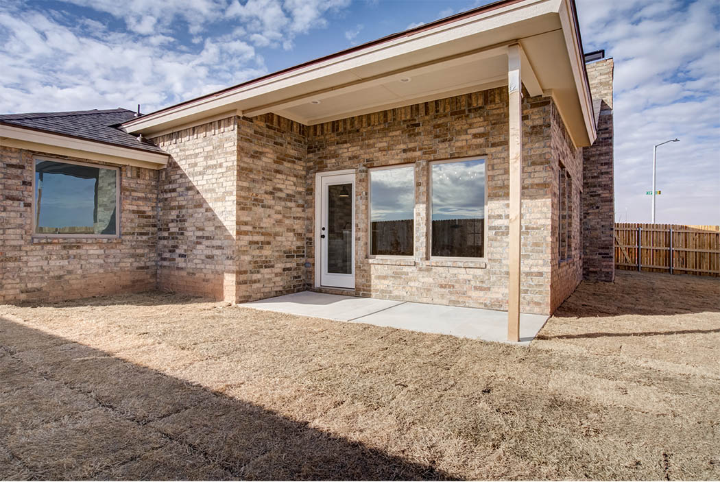 Back patio of beautiful new Lubbock home for sale by Sharkey Custom Homes.