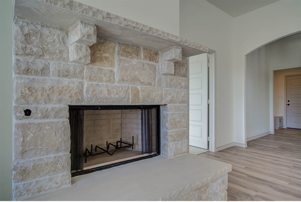 Fireplace detail in living area of beautiful new home for sale.
