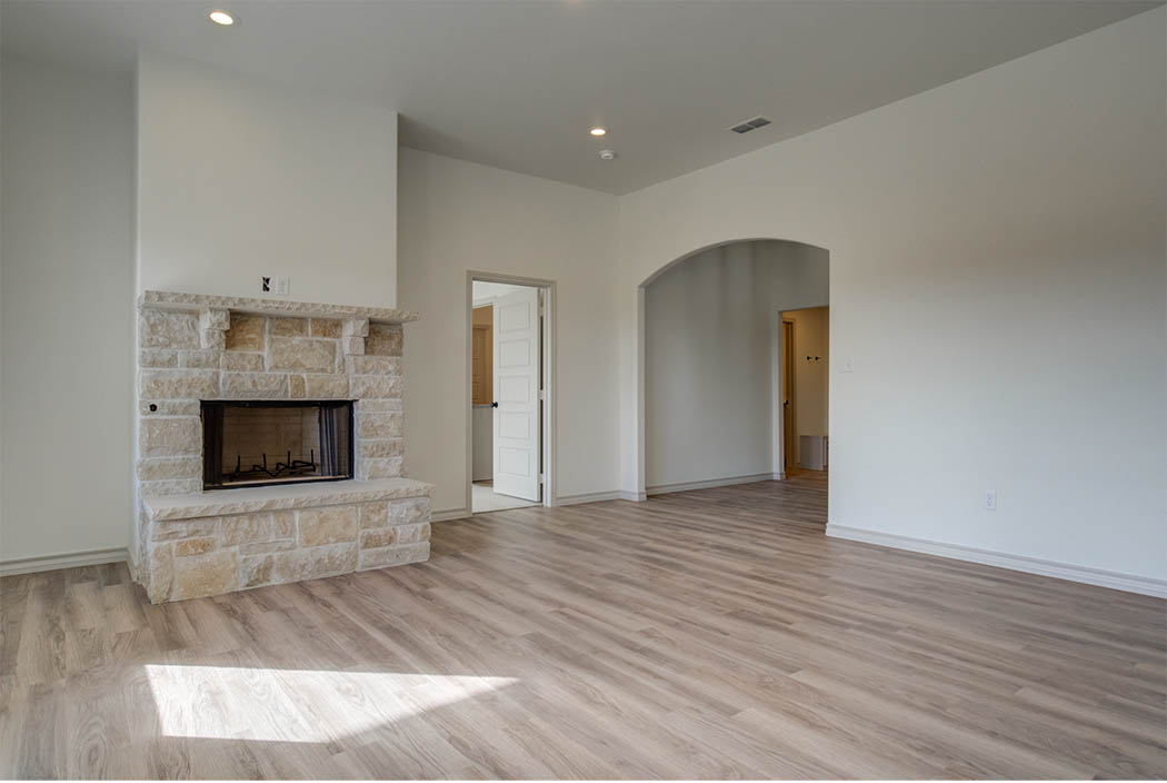 Spacious living area with fireplace in new home for sale in Lubbock.