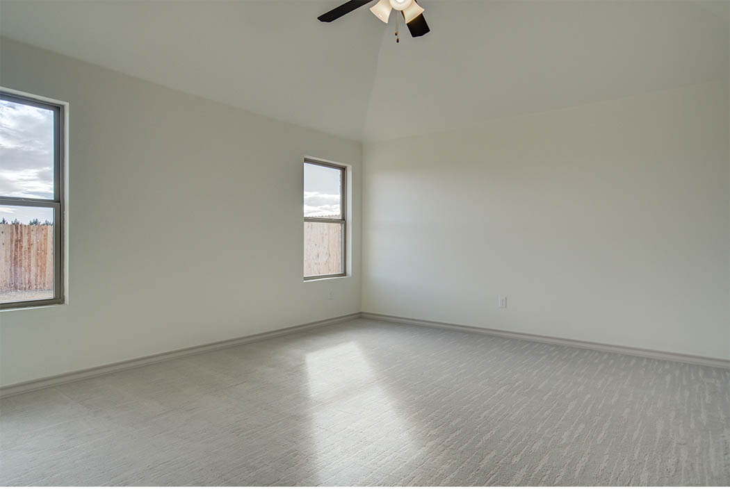 Spacious master bedroom of Lubbock home for sale by Sharkey Custom Homes.
