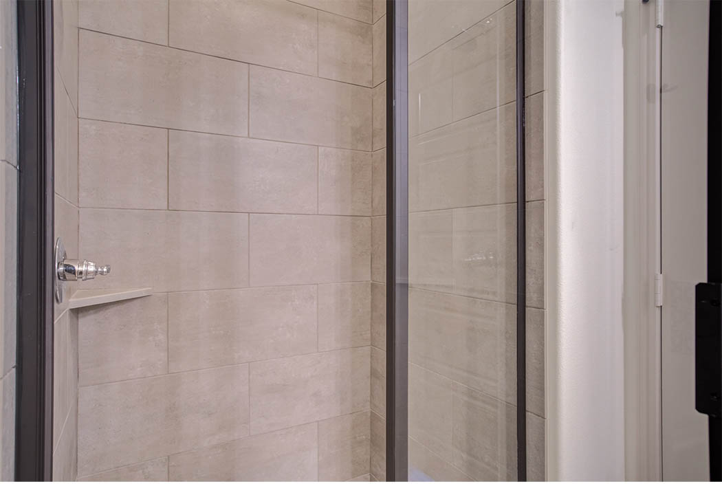 Detail of beautiful shower in new home for sale in Lubbock, Texas by Sharkey Custom Homes.
