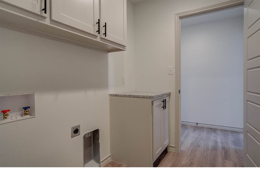 Roomy laundry area in new home for sale in Lubbock.
