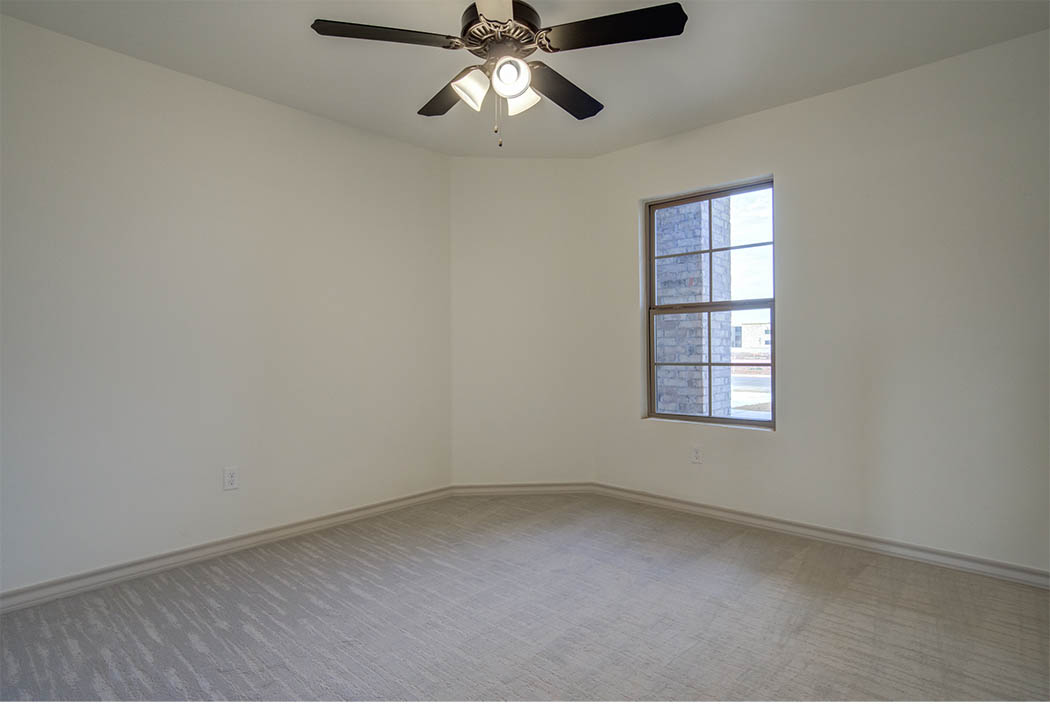 Spacious bedroom or office area in new home for sale in Lubbock.