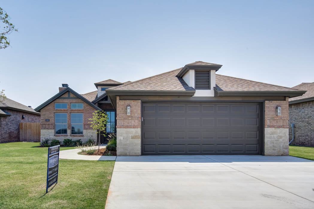 Exterior of beautiful new home for sale in Lubbock, Texas, showing garage.