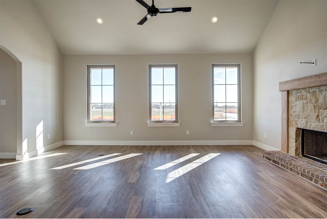 Spacious laundry room with lots of windows in home for sale in Lubbock.