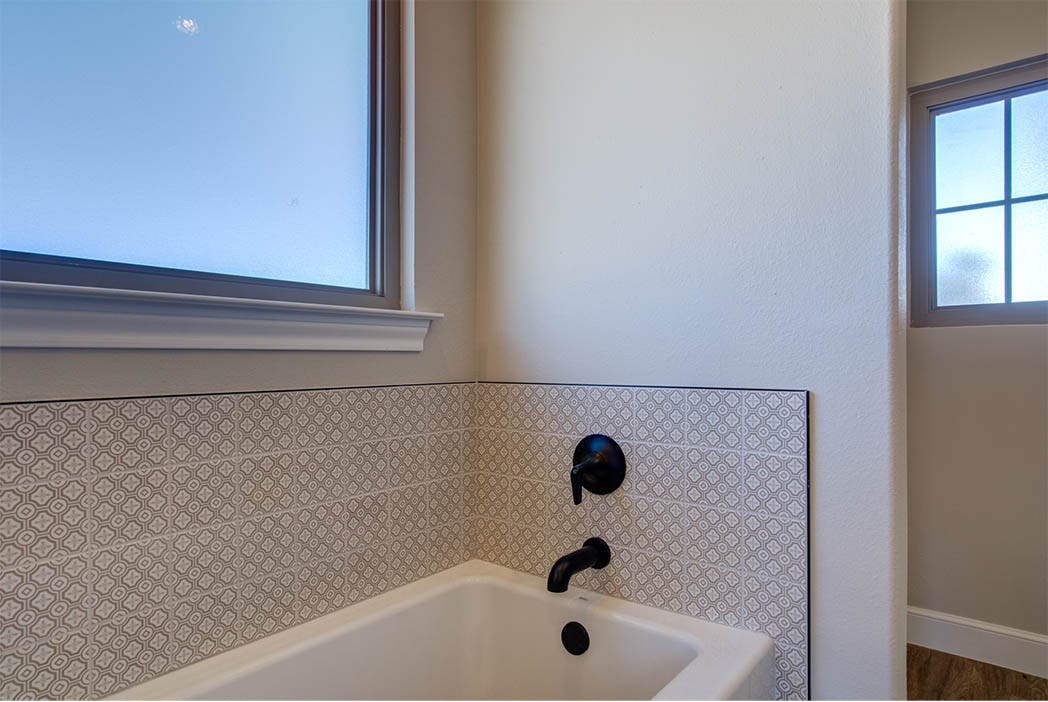 Bath with beautiful tile work in new home in Lubbock, Texas.