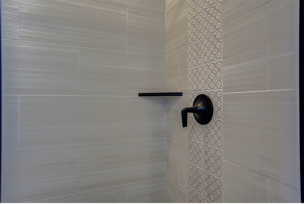 Detail of shower in new home for sale in Lubbock.