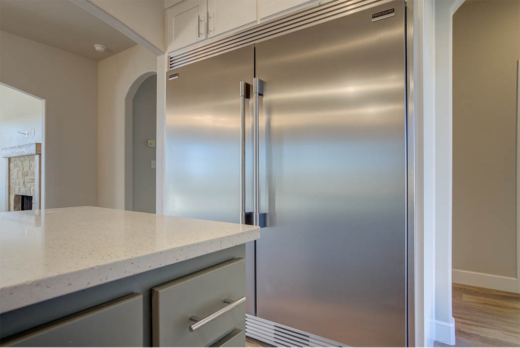 Double refrigerator/freezer in beautiful kitchen in home for sale.