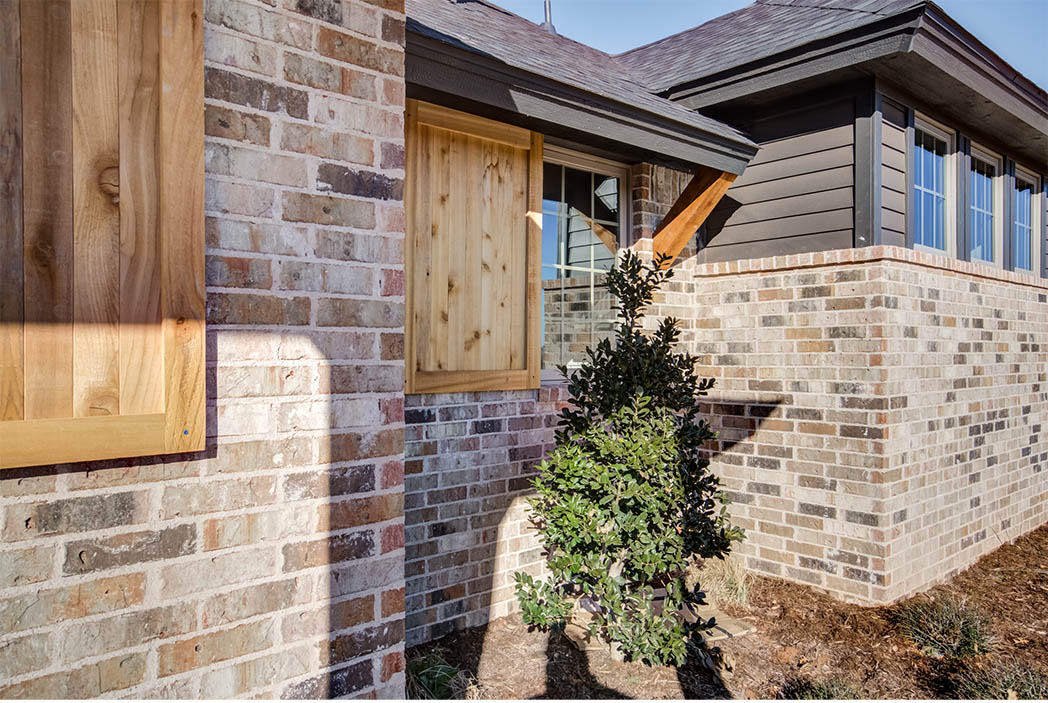Detail of exterior front windows of new Lubbock home for sale.