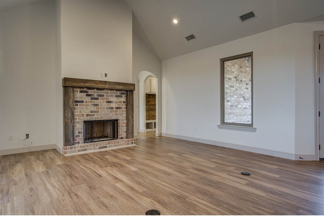 Living area with large windows in home for sale in Lubbock.