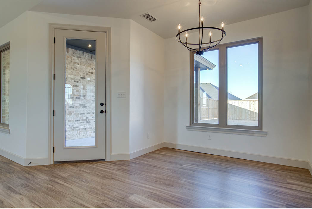 Dining area in new Lubbock home for sale, with exterior patio door.