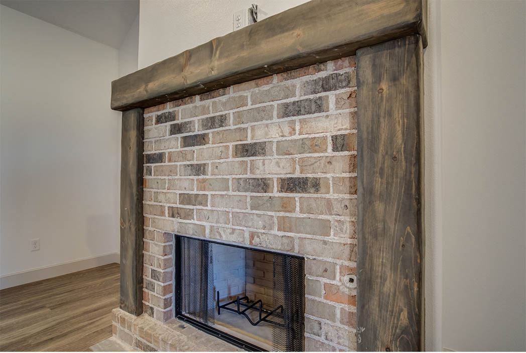 Detail of fireplace in living area of new home for sale.