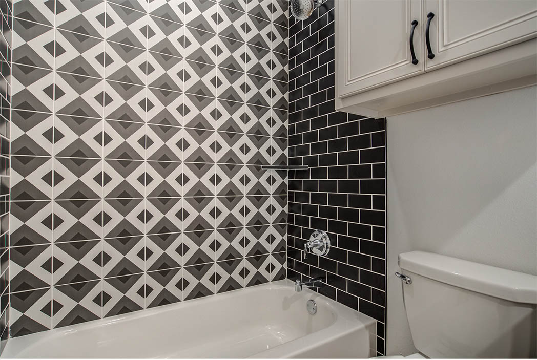 Detail of tile work in beautiful bathroom in home for sale in Lubbock, Texas.
