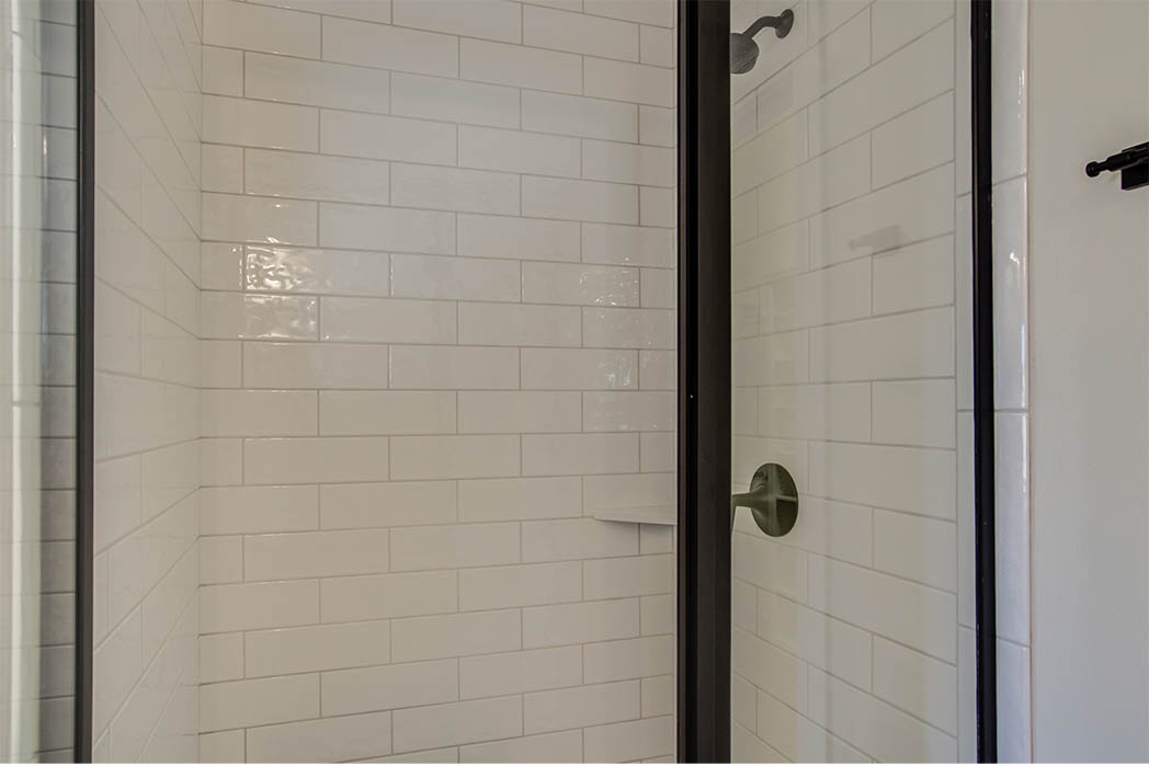 Beautiful tile detail in master bath shower, in new home for sale in Lubbock, Texas.