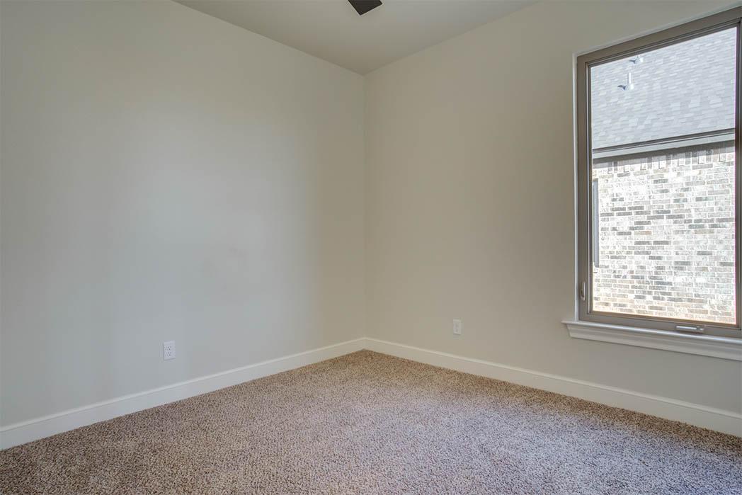 Guest bedroom in home for sale in Lubbock.