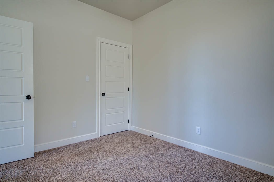 Guest bedroom in beautiful new home for sale in Lubbock.