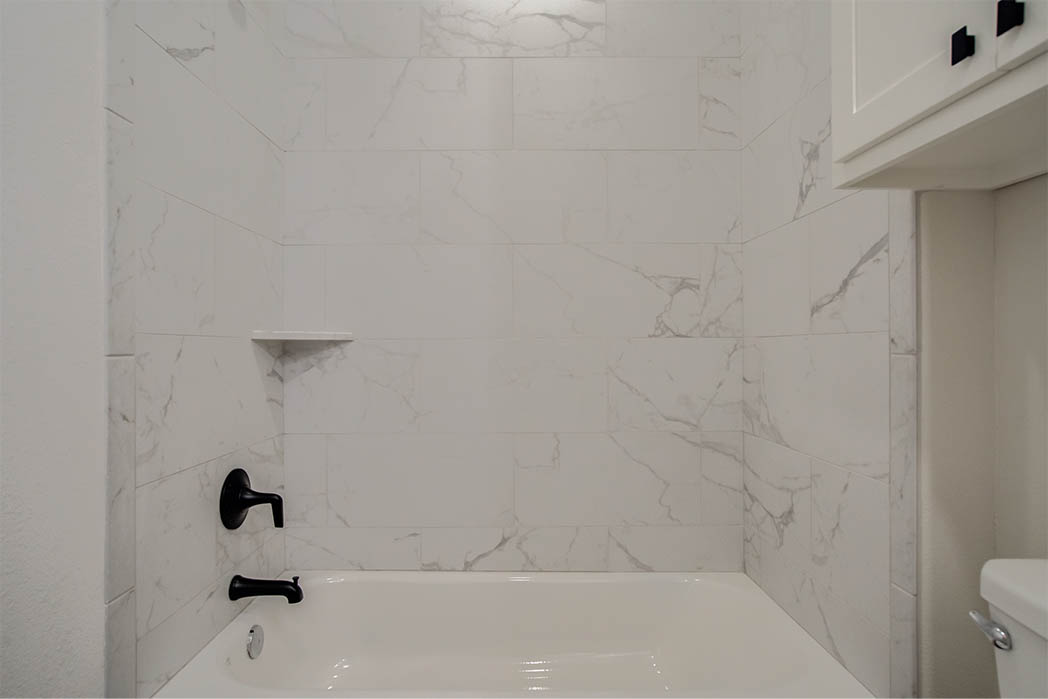 Shower in guest bath in new home for sale in Lubbock.