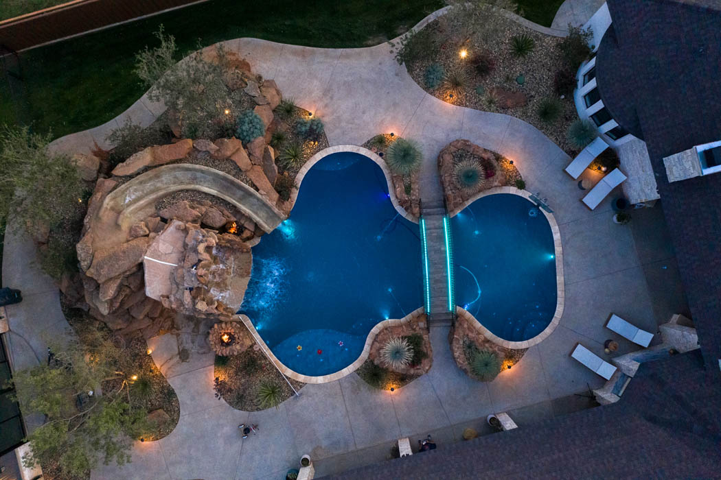 Overhead view of amazing backyard pool area of Lubbock custom home.