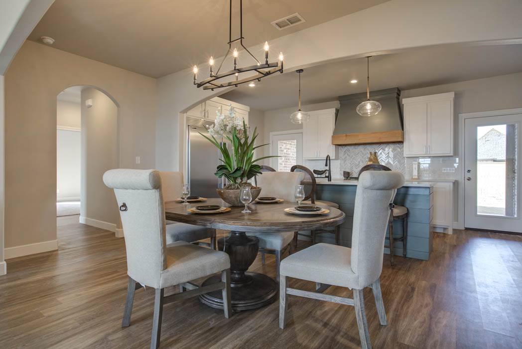 View of spacious dining area in new home in Lubbock, Texas.