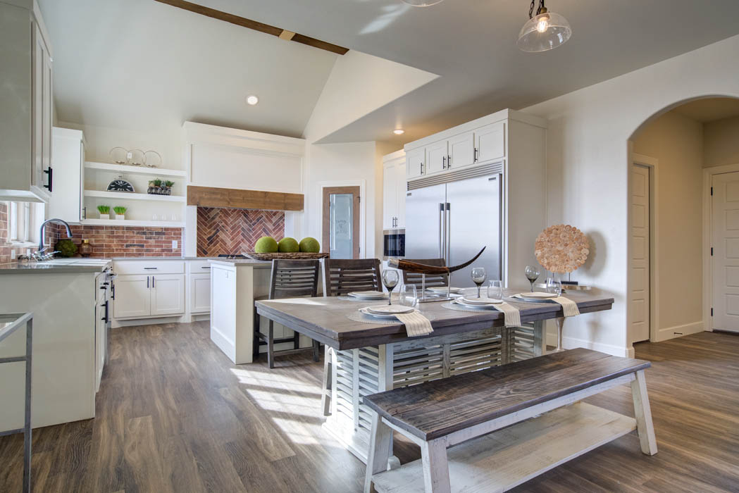 Dining area with view of spacious kitchen in new Lubbock home for sale.