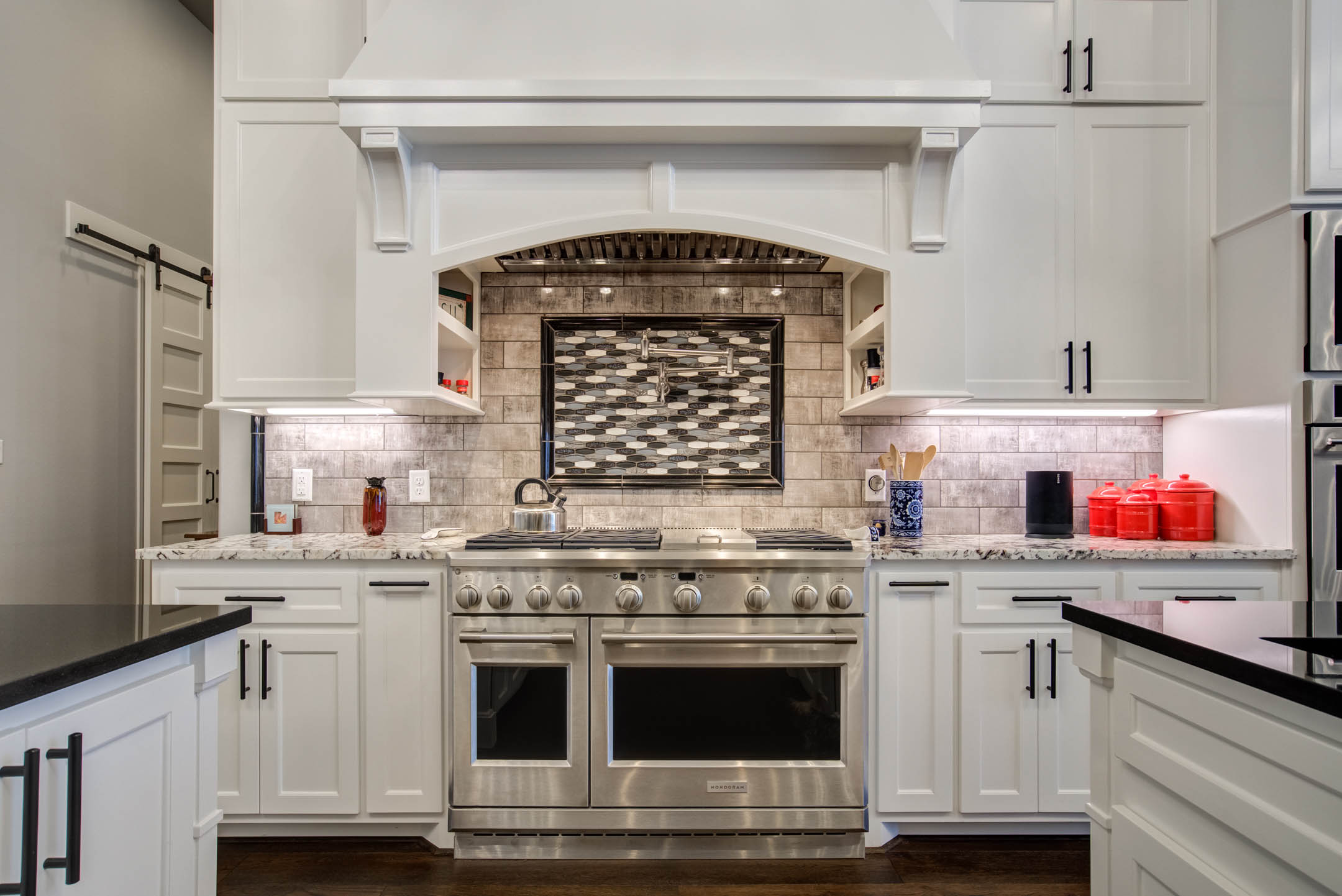 Stove area with beautiful tile treatment in kitchen of custom home in Lubbock.