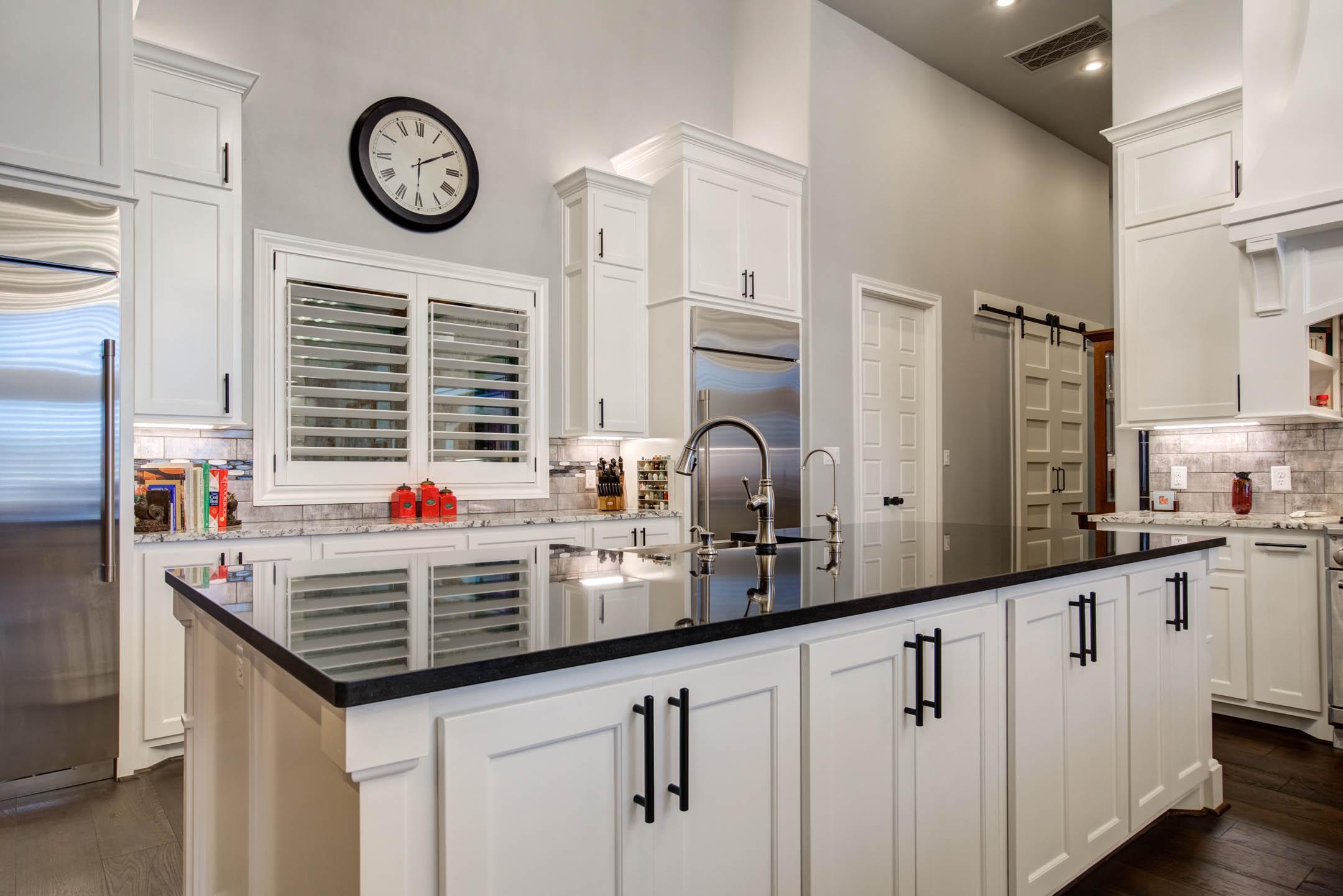 Center island in kitchen of custom home.