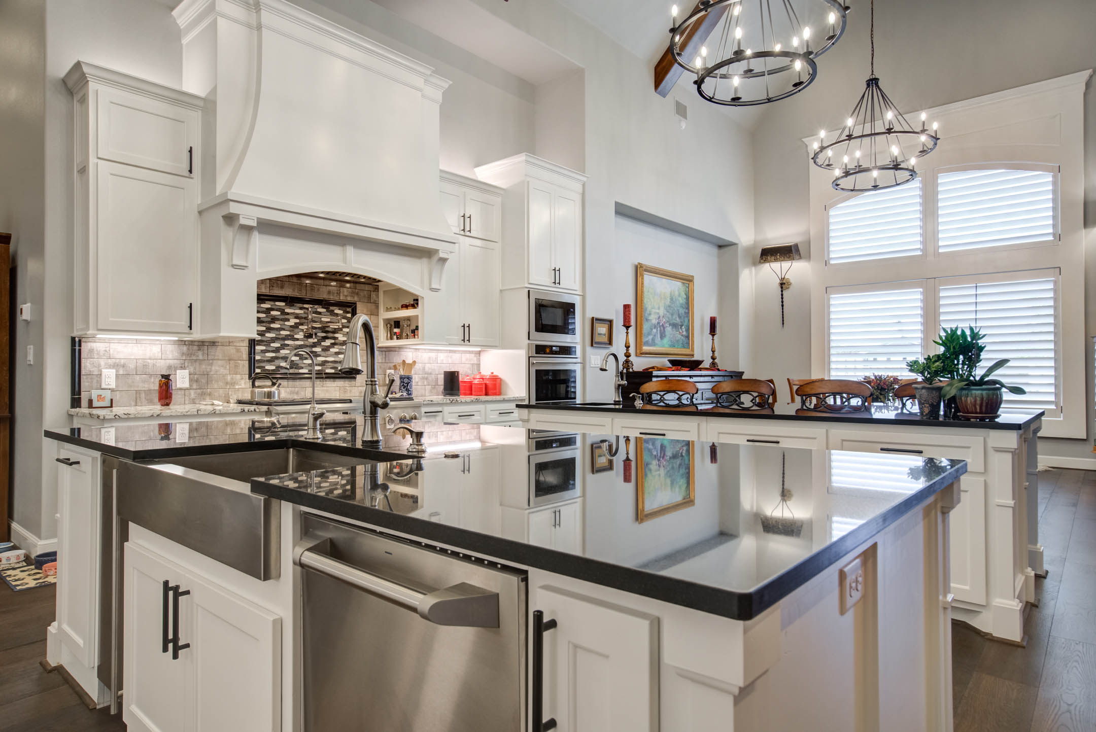 Kitchen island with appliances in custom home.