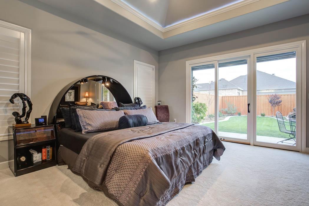 Spacious master bedroom in custom home in Lubbock, Texas.