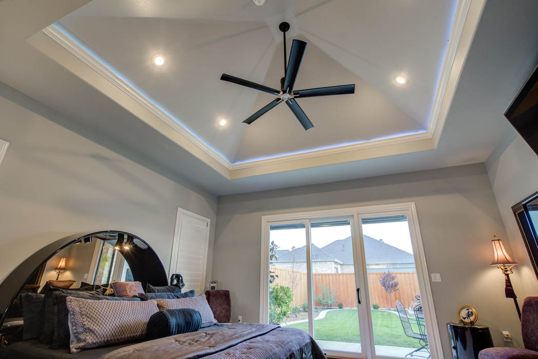 Spacious master bedroom with beautiful vaulted ceiling in custom home in Lubbock, Texas.