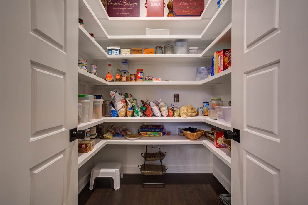 Spacious pantry in kitchen of custom home built by Sharkey Custom Homes, in Lubbock.