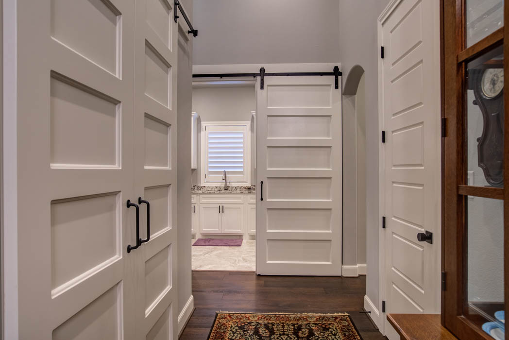 Spacious intersecting hallway for bedrooms in custom home in Lubbock.