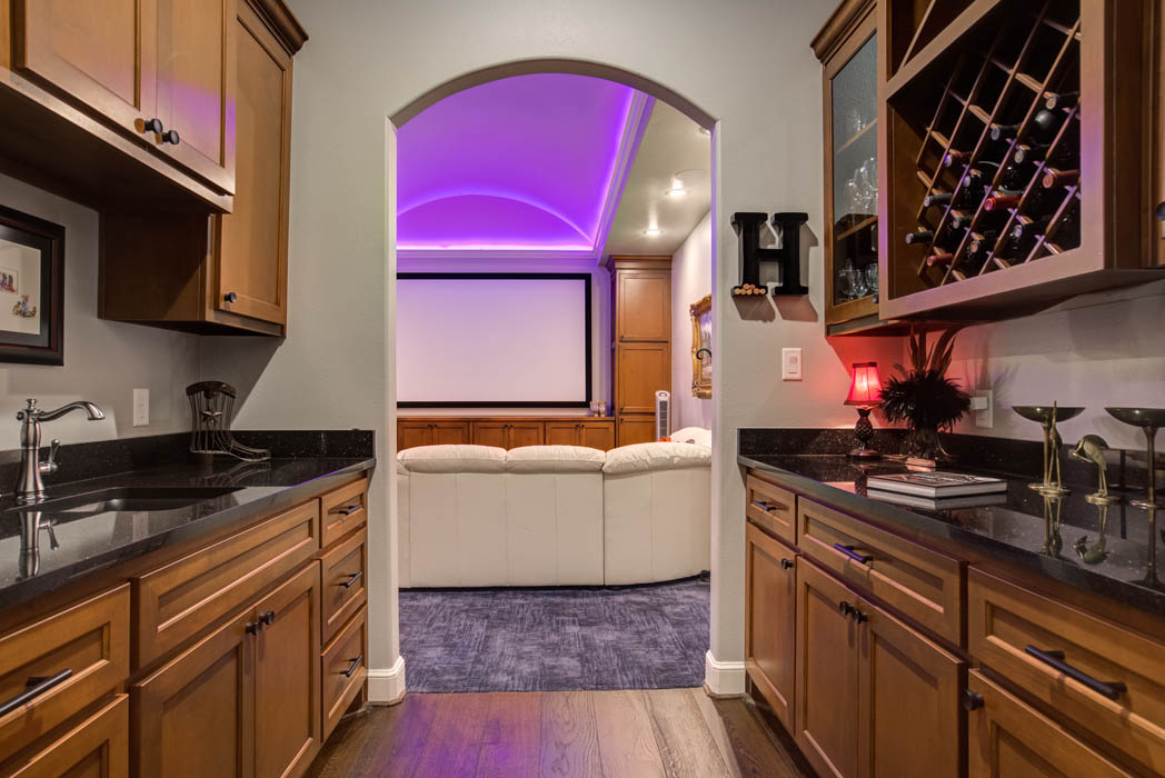 Theatre room with amazing mood lighting in custom home in Lubbock.