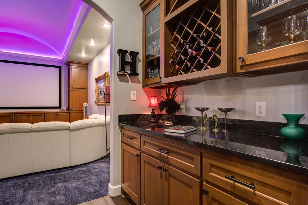 View of beverage bar adjacent to home theatre in custom home.