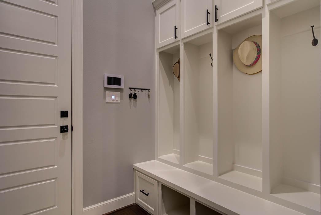 Laundry-mud room area in custom home in Lubbock.