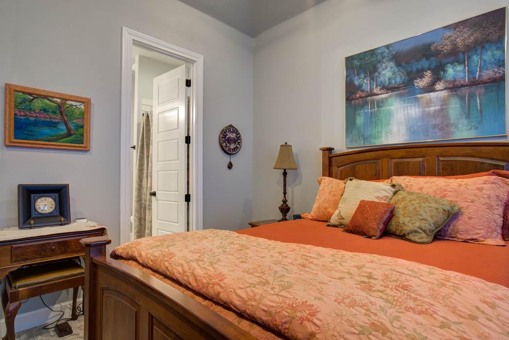 View of spacious bedroom in custom home built in Lubbock.