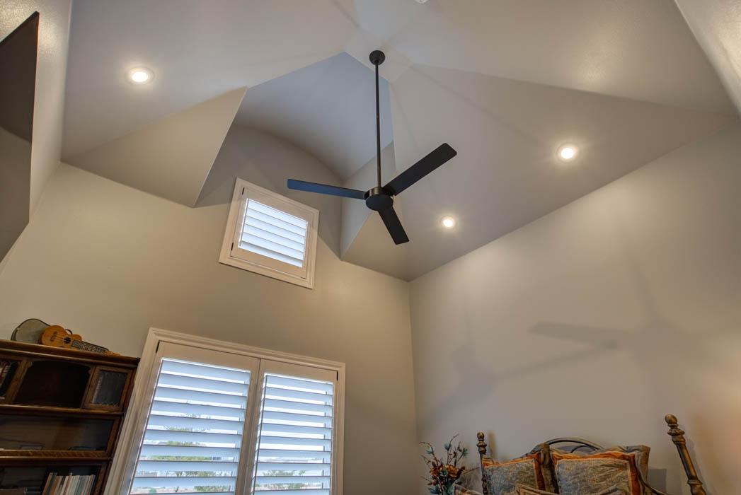 Vaulted ceiling in guest bedroom of custom home in Lubbock, Texas.