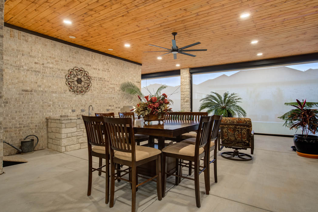 Spacious outdoor patio with nice furniture, in custom home in Lubbock, Texas.