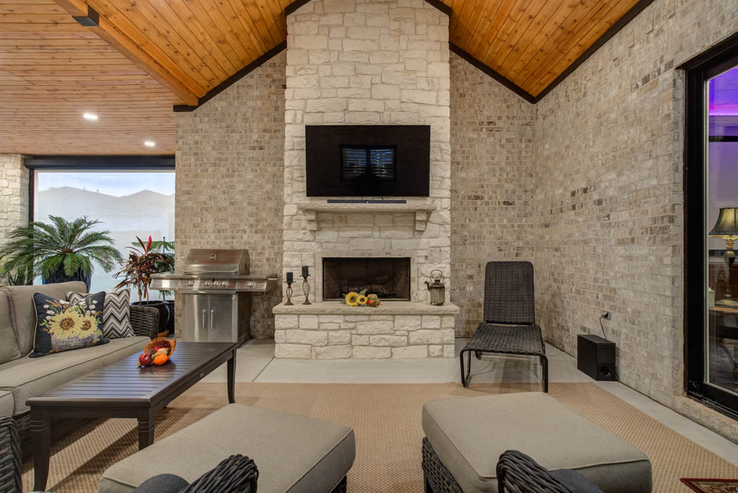Detail of outdoor patio area fireplace in custom home in Lubbock.