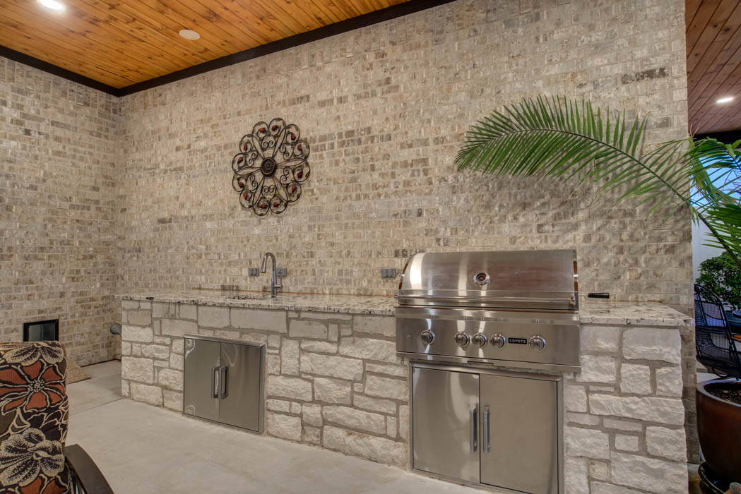 Outdoor kitchen in spacious covered patio in beautiful Lubbock home.