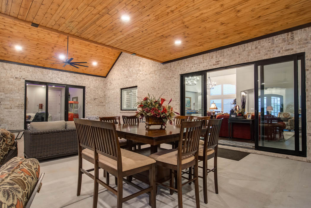 Dining table on covered patio in Lubbock area home.