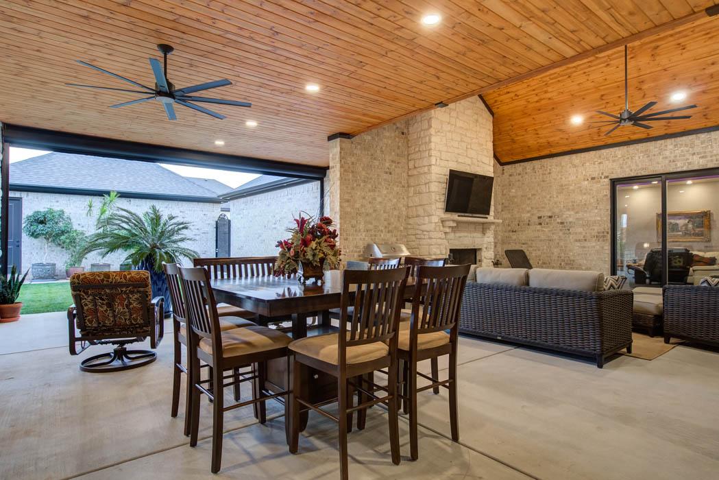 Spacious outdoor living area in custom Lubbock home.