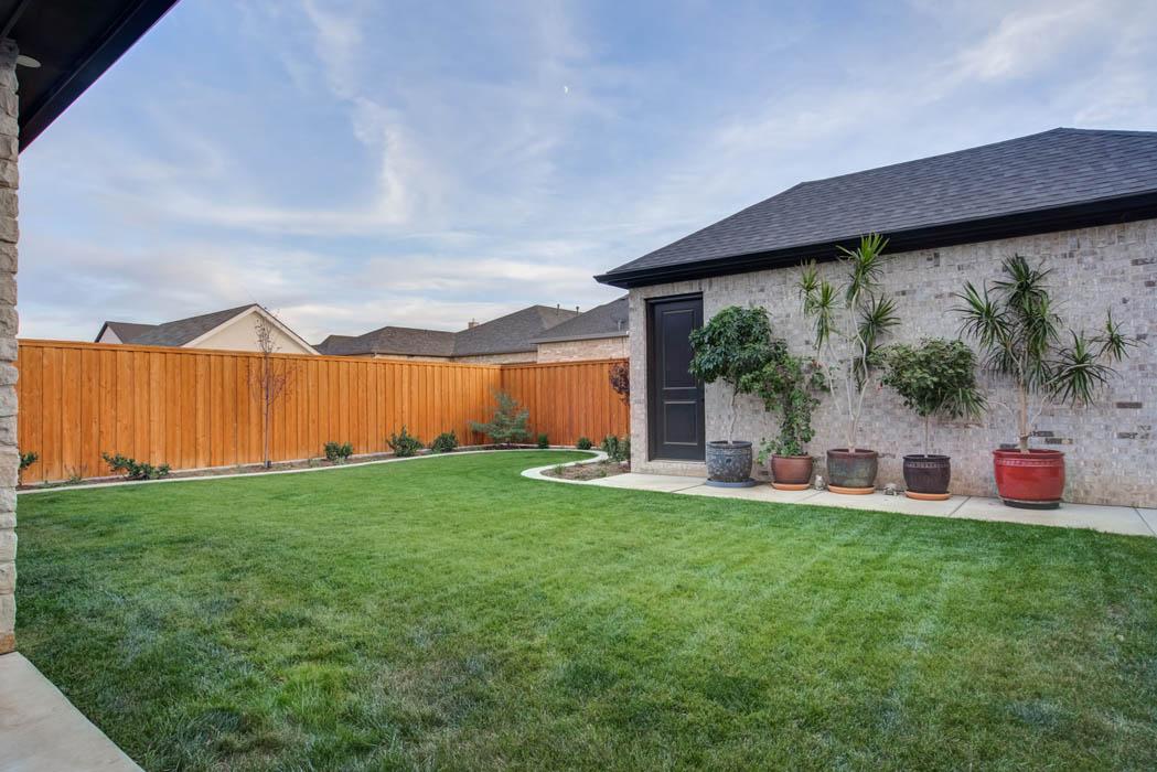 Spacious backyard of custom home in Lubbock, Texas.