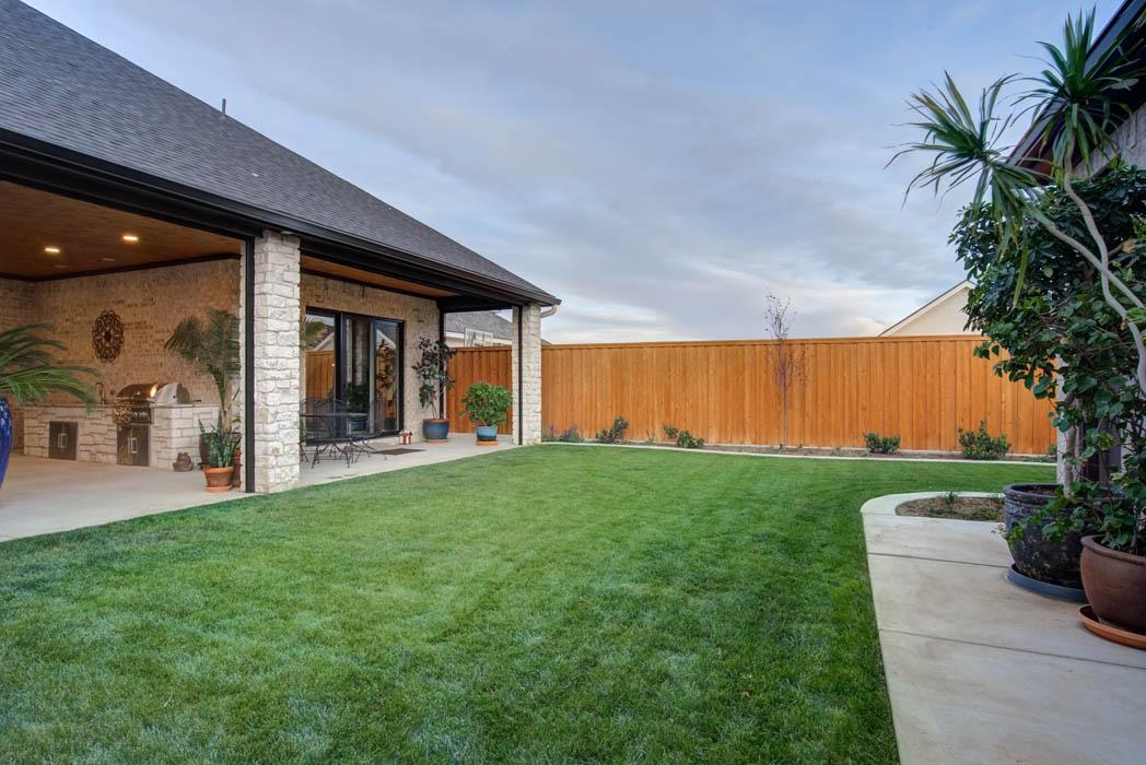 Spacious backyard of custom home built in Lubbock.