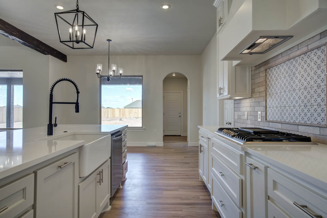 View of kitchen and sink in new house for sale by Sharkey Custom Homes.